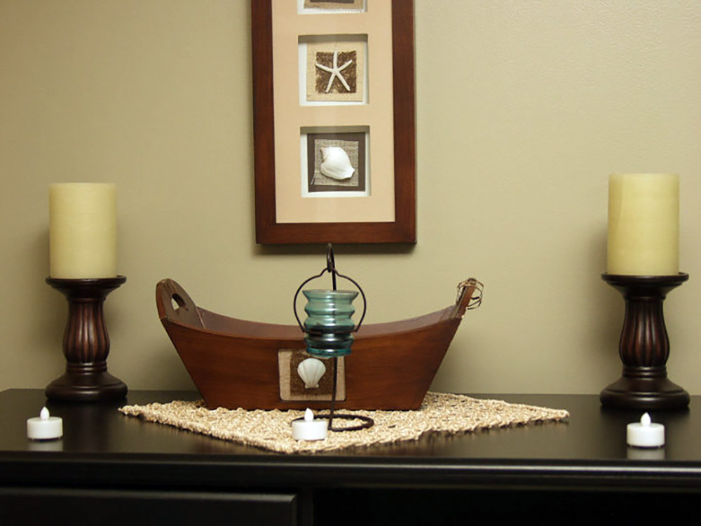 Time For You Massage side table with candles and assortment of relaxing artwork and decorations