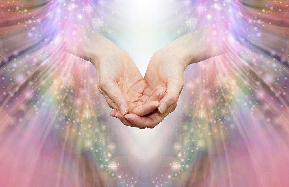 Energy healer receiving high vibrational energy