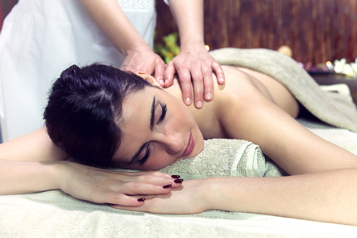 Happy sleeping relaxing woman in spa